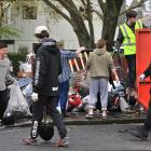 Students stuff skips with rubbish during a memorial clean-up for Sophia Crestani in Dunedin's...