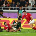 Damian de Allende scores for the Springboks during their World Cup semifinal win over Wales last...
