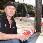 Dunedin man Les Carty is refusing to be called a hero after stopping two people from being...