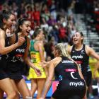 Ameliaranne Ekenasio, Maria Folau and Laura Landman of New Zealand celebrate after winning the...