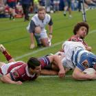Dalton Papalii of Auckland beats Josh Moorby (L) and Isaac Te Tamaki of Southland to the line at...