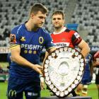 Otago captain Michael Collins presents his Canterbury counterpart, Luke Whitelock, with the...