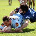 Northland winger Jordan Hyland scores in the tackle of Otago halfback Rowan Gouws in Whangarei...