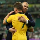 Michael Cheika hugs Wallabies captain Michael Hooper after their loss to England in the World Cup...