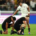 England's Anthony Watson consoles Anton Leinert-Brown and Sam Cane after the All Blacks' semi...