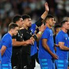 All Blacks players thank the fans after their semi-final loss to England in Yokohama. Photo:...