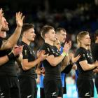 All Blacks players thank the crowd after their semifinal loss to England. Photo: Getty