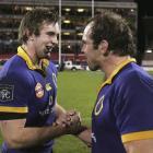 Otago's Matt Saunders (left) and Anton Oliver celebrate beating Canterbury 37-22 in an NPC...