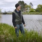 Henley resident Allan Innes stands on a flood bank protecting the settlement. Photos: Gerard O...