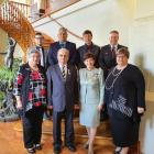 Neill Price, second left at front, had plenty of family support when he received his Queen's...