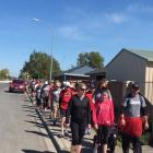 """Walkers make their way around Rangiora's streets during the 8km """"walk for awareness'' on Sunday...."""