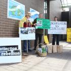 Councillors were greeted by the local Extinction Rebellion group in Invercargill as they made...