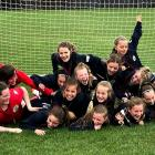 The winning Southland United under-12 girls team was greeted by supportive family members who...