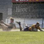 North Otago winger Howard Packman splashes in for one of his two tries against Wairarapa-Bush in...