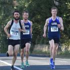Jonah Smith (left), Jason Palmer (centre) and defending champion Nic Bathgate pull away from the...