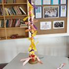Ribbons tied to a candlestick, on display at Alexandra's Catholic Church of St John the Baptist,...