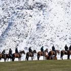 Riders line a ridge near the film set in the Ahuriri Valley. Photo: Stephen Jaquiery