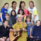 Natalie Yeoman sings one of the songs from her new CD with George Street Normal School pupils....