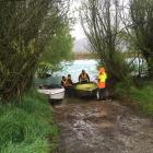 Crews prepare to launch a pair of jet boats into the Waitaki River near Duntroon in the search...