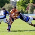 Lemi Masoe of North Otago is tackled during the Mitre 10 Heartland Championship Meads Cup Final...