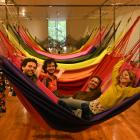 OPAVIVARA! members play in their hammocks at the Dunedin Public Art Gallery. Photo: Linda Robertson