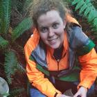 Environment Southland biosecurity officer - pest plants Rachel Batley resets a trap in a native...