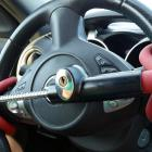 Anti-Theft Car Steering Wheel Lock. Black & red colors. Photo: Getty Images