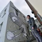 Artist Simon Ormerod, also known as Cracked Ink, is working on a large addition to Dunedin's...