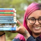 Author Swapna Haddow with some of her output. Photo: Peter McIntosh