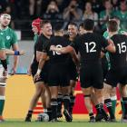 The All Blacks congratulate George Bridge during their comprehensive win over Ireland in Tokyo....
