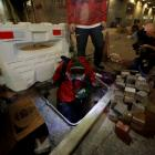 A protester tries to escape through a sewage tunnel inside the Hong Kong Polytechnic University...