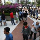 Voters queue to vote at a polling station during district council local elections in Hong Kong....