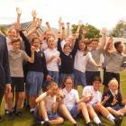 Cromwell College principal Mason Stretch (left) stands alongside a flock of year 7 pupils. Photo:...