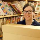 Central Otago District Council digitisation assistant Chloe Perry on the job in Alexandra...