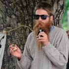 Abe Gray uses a cannabis vaporiser on the Union Lawn on Monday. Photo by ODT.