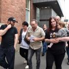 Shane Rush (centre) and family leave after a jury in the High Court at Dunedin yesterday found...