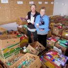 Ashburton County Lions members Janet Kingsbury and Jackie Ryan with some of the boxed items.