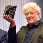 Receiving the Bluestone Award from Dunedin Mayor Aaron Hawkins (left) for his work in restoring...