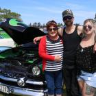 Lavina (left) and Brad Bisschop with Sasha Jones and their alien-themed 1952 Ford Twin Spinner at...