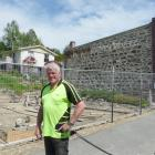 Project manager David Latta stands at the site of a controversial new building in Ross Pl,...