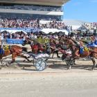 Driver Tim Williams salutes the Addington crowd as Chase Auckland wins the New Zealand Free-For...