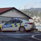 Police at the scene of the crash this morning near The Cove. Photo: Peter McIntosh