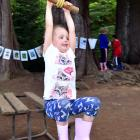 Maddy Gaston (4) from Fairfield, swings into Creekfest at Chingford Park yesterday.PHOTOS: GREGOR...