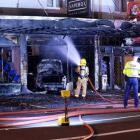 It's believed the car was deliberately driven into the VapeBox building, setting it alight. Photo...