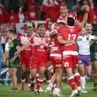 Tongan players celebrate their histoic win over Australia in Auckland. Photo: Getty Images