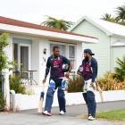 England players Chris Jordan (left) and Adil Rashid walk along the street outside McLean Parkin...