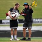 New Zealand captain Kane Williamson speaks with groundsman Karl Johnson during a nets session at...