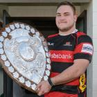 Canterbury's Joel Hintz poses with the Ranfurly Shield following the team's match against Mid...