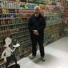 Stu Reed with some of his collection of 100,000 beer cans. Photo: Rachel MacDonald