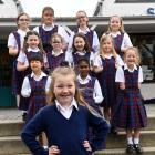 Modelling the shorts she is now allowed to wear is St Francis Xavier School pupil Kayleigh Dryden...